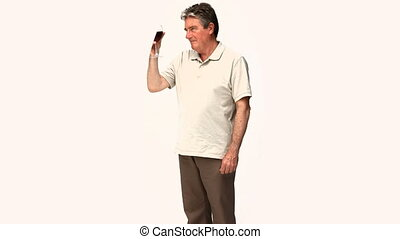 Mature man trying a glasss of wine