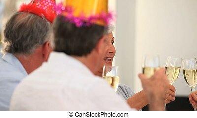 Mature Friends celebrating a birthday