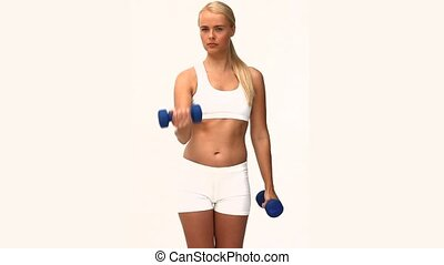 Blond woman doing exercises against a white background