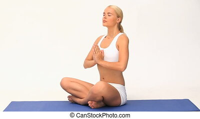 Pretty blond woman doing yoga isolated on a whitebackground
