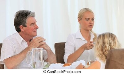 Pretty family eating at the table