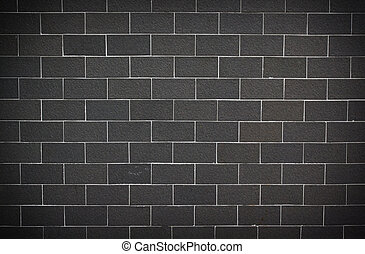 Gray and white cinder block for background.