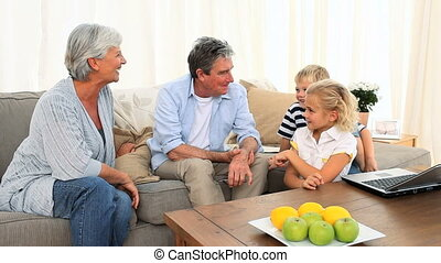 Family talking together - Family talking in the living room
