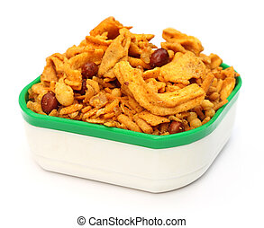 Chanachur or Bombay mix on a bowl over white background