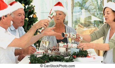Senior friends celebrating Christmas in the living room