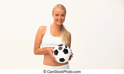 Blond Woman playing with a ball against a white background
