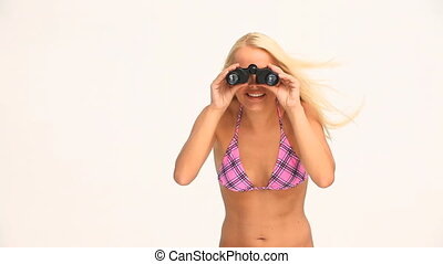 Blond woman looking at someone with a pair of  binoculars