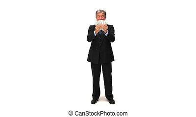 Mature businessman showing us his cash against a white...