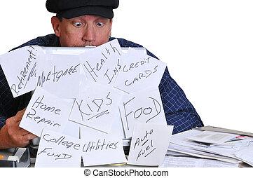 Man looking down at his bills