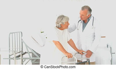 A doctor visiting his patient at the hospital
