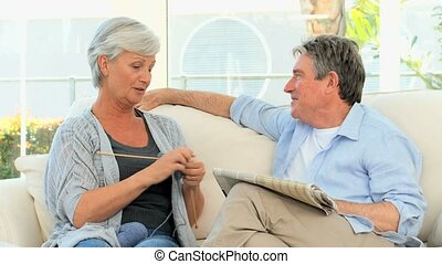 Retired couple talking on the sofa