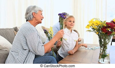 Family making a brunch of flowers in the living room