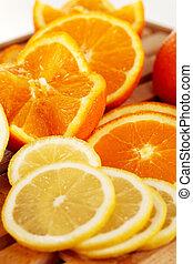 Orange and lemon slices 2 - Orange and lemon slices on a...