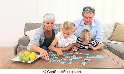 Family doing a puzzle in the living room