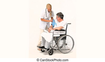 Senior man has a nurse visit against a white background