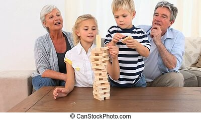 Family playing a game in the living room
