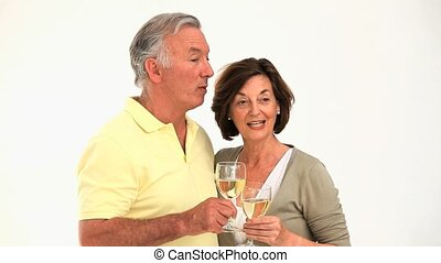 Retired couple celebrating isolated on a white background