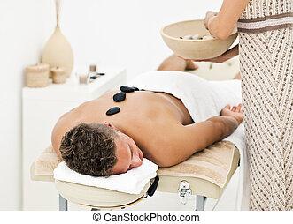 Young man enjoying spa treatment - Young man enjoying the...
