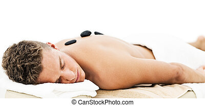 Young man enjoying spa treatment - Young man enjoying the...