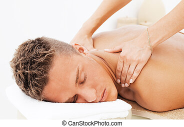 Young man getting spa treatment - Young man enjoying the...