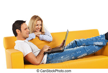 Happy couple with laptop computer - Happy young man and...