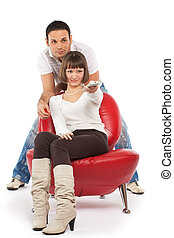 TV show - Attractive young couple watching TV; isolated on...