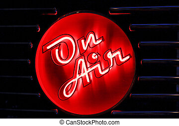 On Air - A red and white neon on air sign with blue neon on...