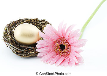 Let Your Nest Egg Blossom - Gold egg in twig nest next to...