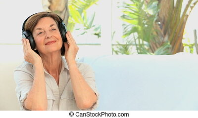 Mature woman listening to music