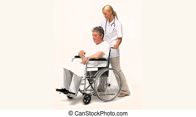 Man in wheelchair with his nurse isolated on a white...