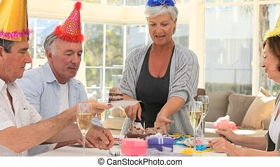 Retired friends celebrating a birthday