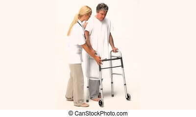 A nurse helping a patient to walk isolated on a white...