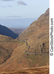 Mountain pass. - A mountainous landscape with high flanks...
