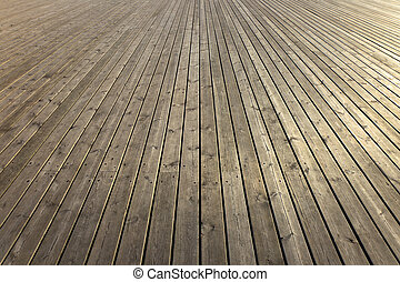 Wooden planks that make up a large pier