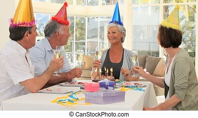 Elderly friends celebrating a birthday