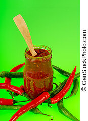 Hot pepper paste named sambal with many fresh red and green...