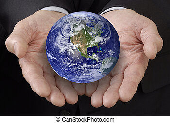 World in your hands - Business man holding the world in his...