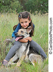 child and baby wolf - little girl and her baby purebred wolf...