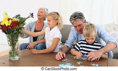 Grand parent playing with their grandson and grand-daughter