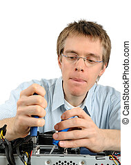 Young technician repairing a PC - Young concentrated...