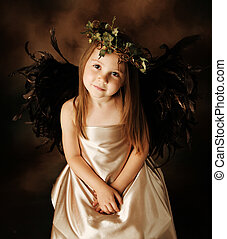 Little Gold and brown angel child - Portrait of a beautiful...