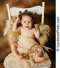 Little Gold and brown angel child with a gold horn -...