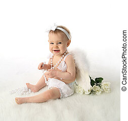 Baby girl angel - Soft portrait of a baby girl wearing white...