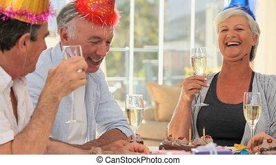 Elderly friends celebrating a birthday