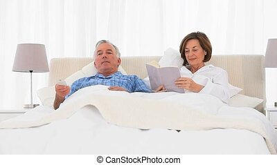Grandsons and Grandparent laughing on the bed