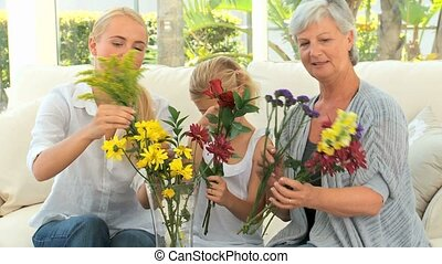 Family putting flowers in a vase