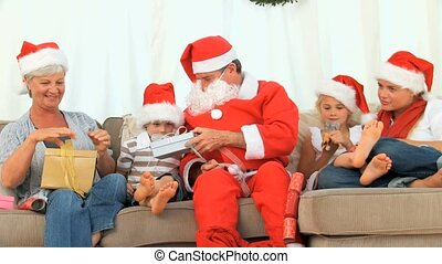 Santa Claus with an happy family