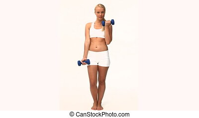 Pretty woman doing exercises isolated on a white background