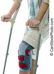 teenager on crutches isolated on white background