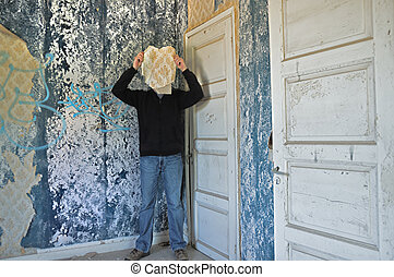 memory mask - Male figure obscured by torn wallpaper shred...